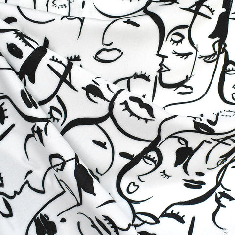 black and white faces in cubist print