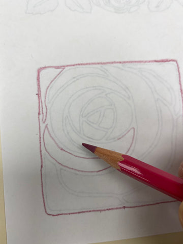 Tracing embroidery design with transfer pencil.