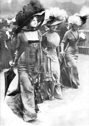 Extravagantly dressed women of Gilded Age