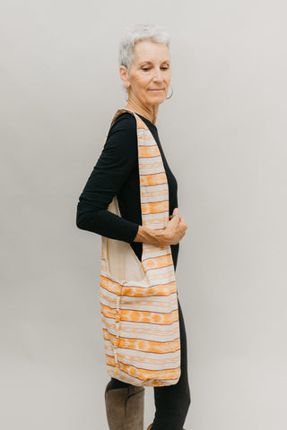 Woman with an orange and white bag