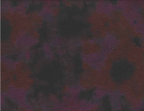 ponte knit fabric abstract magenta and pumpkin colored flowers blurred into dark background