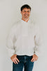Man modeling View B a simple white cotton shirting.  He is wearing denim jeans and standing in front of a white backdrop.
