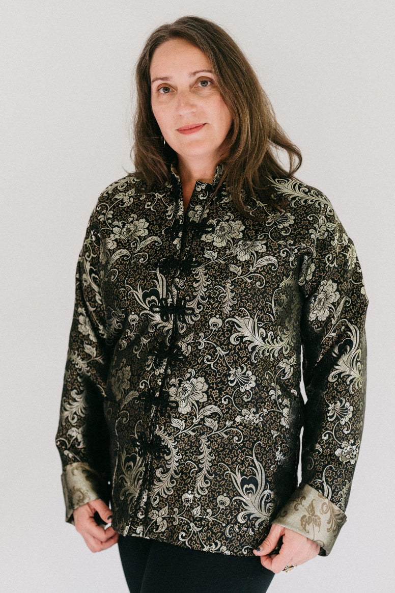 Brunette white woman standing in in front of a white studio backdrop wearing #145 Chinese Pajama jacket