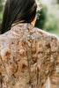 close up back view of brunette woman wearing 205 Gibson Girl Blouse, back fastened with tiny buttons.