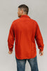 Back view of man standing looking to the left in front of a white studio backdrop wearing 212 Five Frontier Shirts.