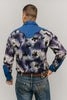 Back view of man standing in front of a white studio backdrop wearing 212 Five Frontier Shirt with decorative yoke in the back.
