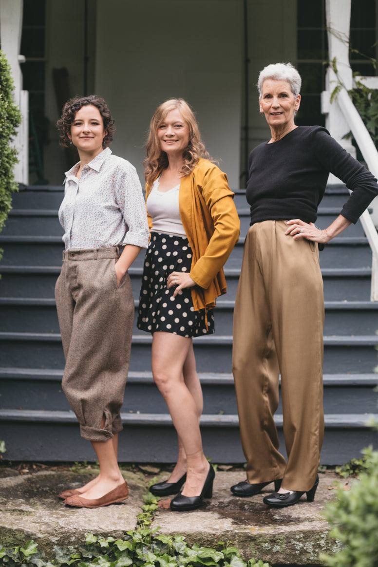Three women, two young women and an older woman wearing the 250 Hollywood pants, one wearing knickers, trousers and shorts