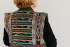 Close up photo of upper back of panel coat.  Coat is made in woven ikat fabric.