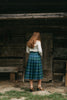 Photo of the back view of the kilt skirt on young woman walking.