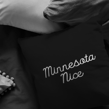 Minnesota Nice Script Pillow in Black and White in a Room