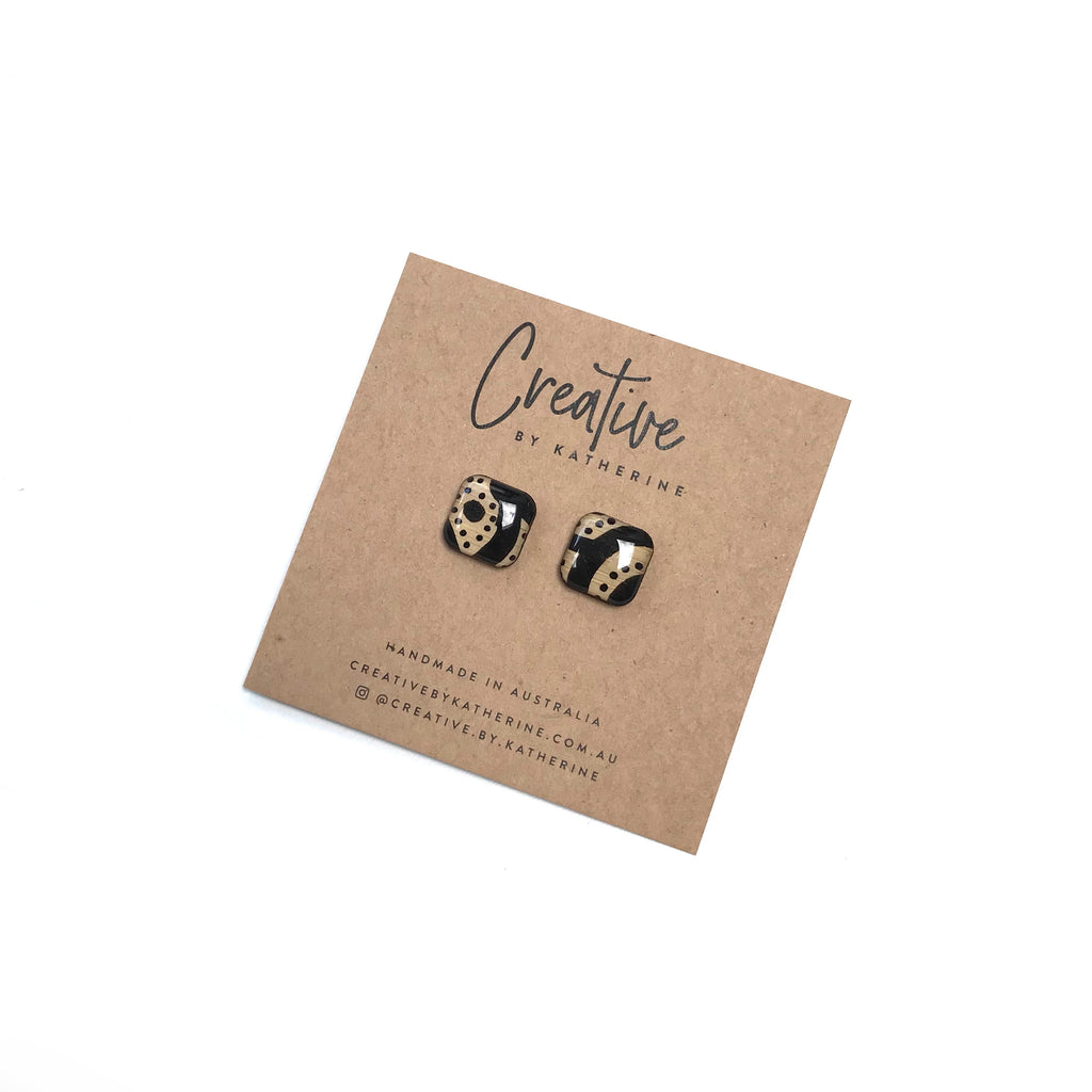 Coloured Karuna - black square studs