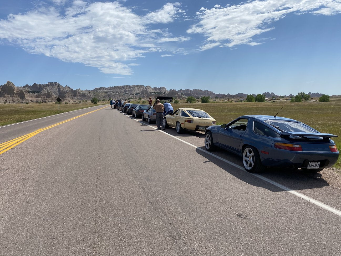 sharks in the badlands 928s event parked at the side of the road