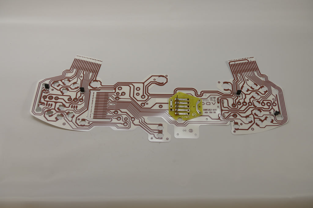 A printed circuit foil for Porsche 928s.