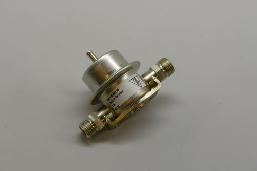 A left rear fuel pressure damper for Porsche 928s.
