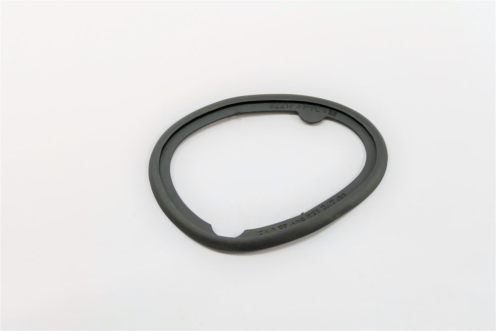 A left side Aero mirror base gasket for Porsche 928s.
