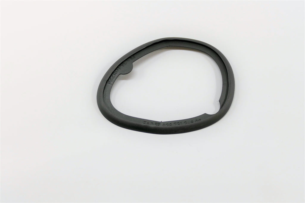 A right side Aero mirror base gasket for Porsche 928s.