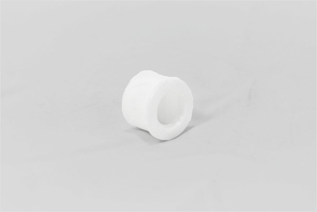 A white original Porsche clutch/shifter ball socket bushing for Porsche 928s.
