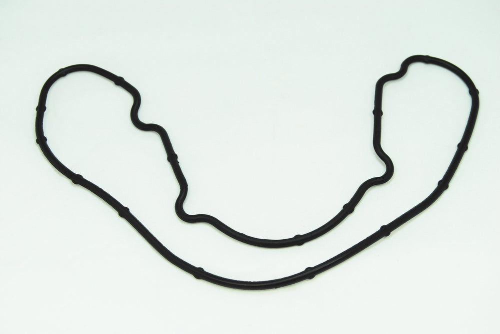 A left side intake side cover gasket for Porsche 928s.