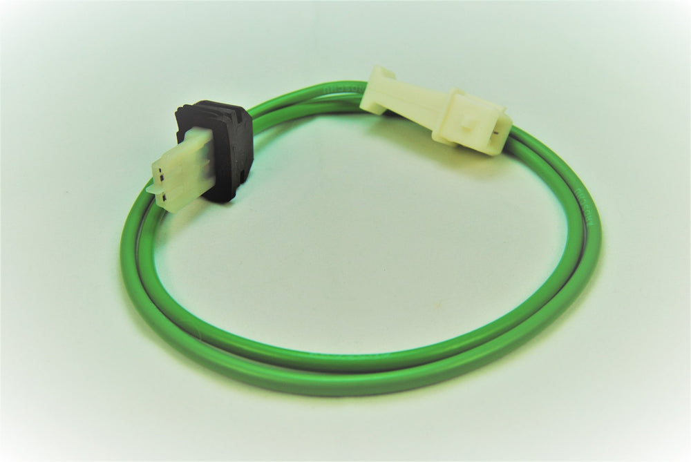 An aftermarket URO distributor wire green wire for Porsche 928s.