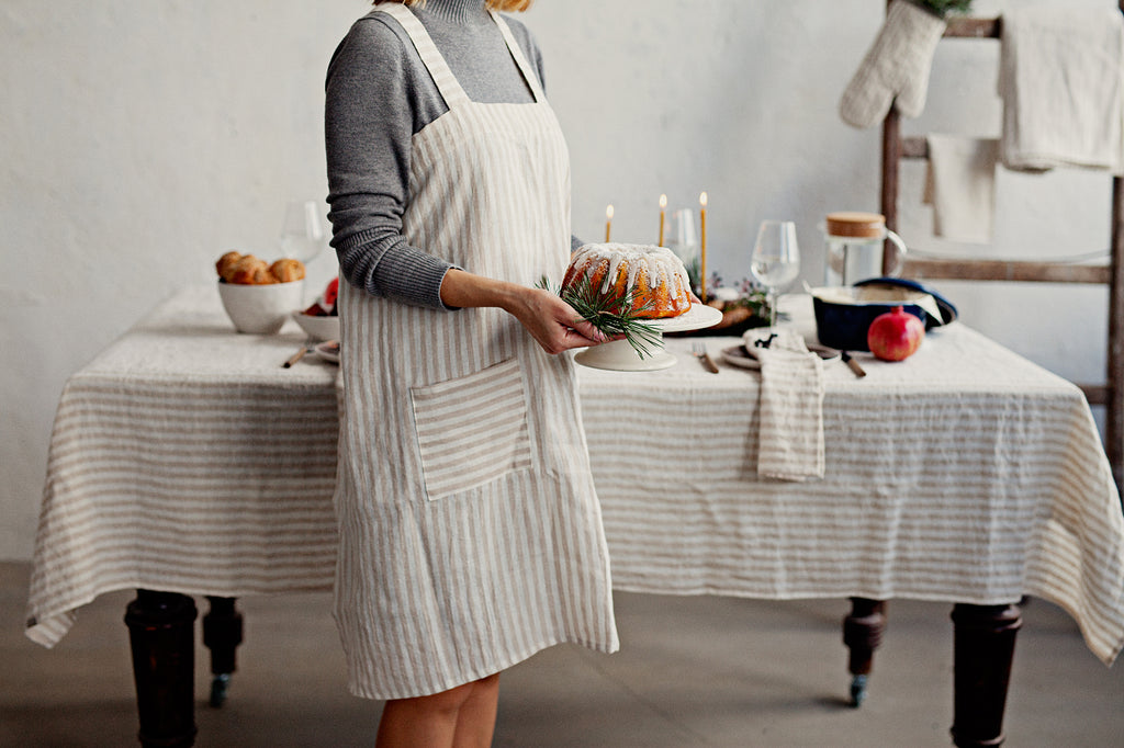 Stonewashed linen pinafore apron striped in white and natural linen color