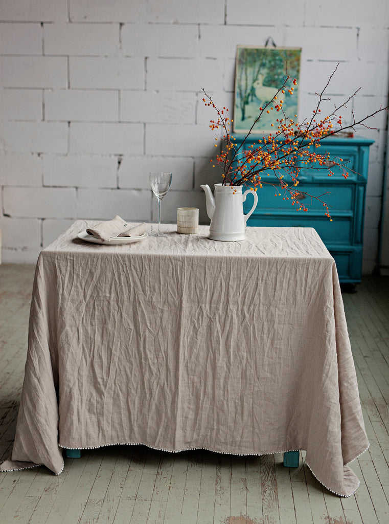 Stonewashed washable rustic linen dining table cover in natural linen color