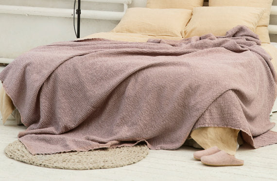 Softened linen waffle blanket in dusty rose