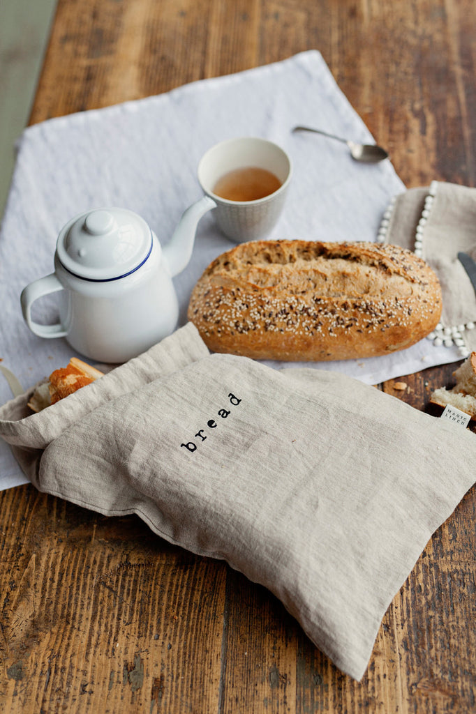 Softened linen bread pouch in natural flax color