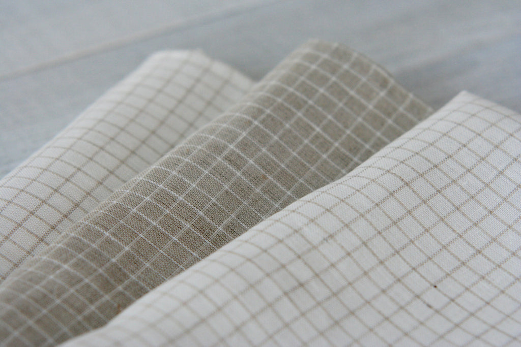 Stonewashed linen tea towels in white and natural linen color with loop for hanging