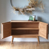 Sideboard with sculpted doors