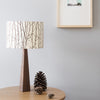 Solid walnut table lamp base and fabric woodland print shade
