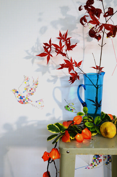 Autumn leaves and coloured glass