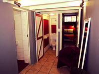 Budget Accommodation in a five bed en-suite family room at Riverlodge Backpackers in Cape Town