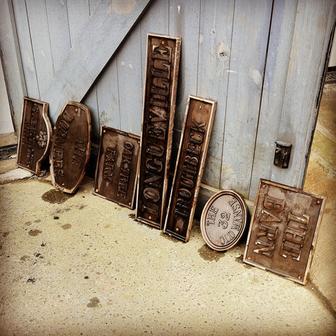 Chemical Treatment On Bronze House Signs