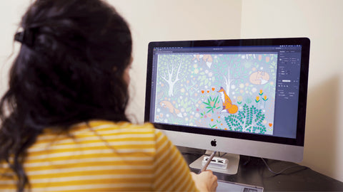 Lois Callis-Smith designing fabric pattern on a mac for Punto Belle