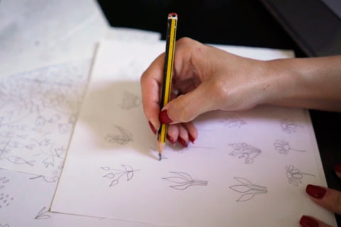 Hand drawing pencil sketches in Punto Belle artist studio