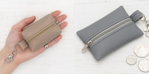 Hand holding a Punto Belle purse and a keyring pouch
