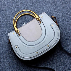 Famous Looking Leather Handbag in baby blue