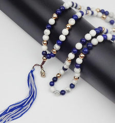 white and blue mala made of natural stones with Buddah head