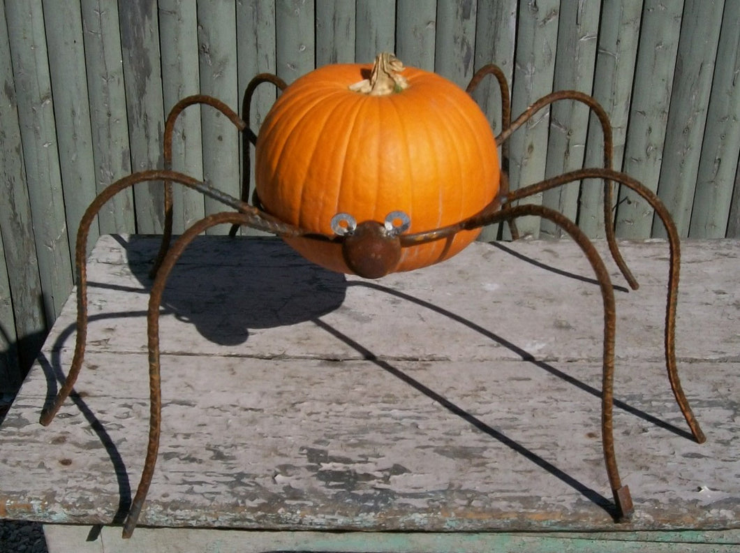 This wrought iron spider could hold a pumpking or a gazing ball Measures 11