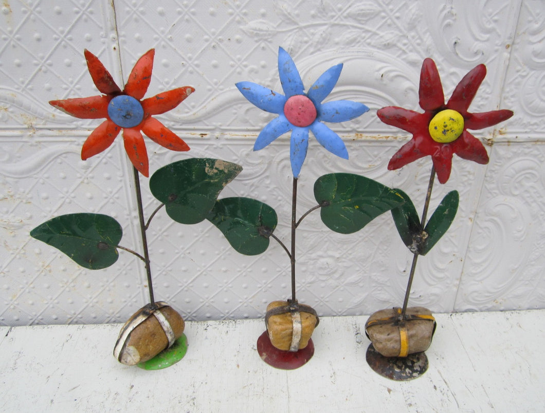 These star flowers are made from recycled metal They have a rock on the bottom so they will free stand Measures 22