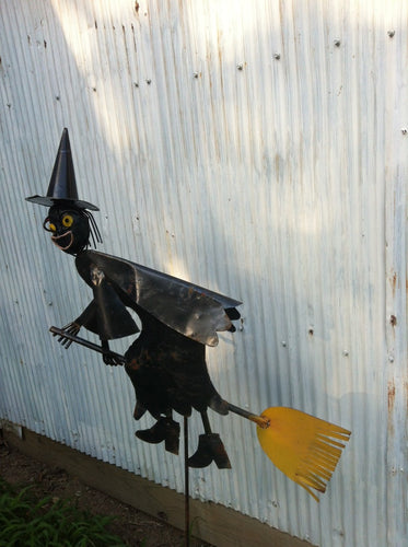 Witch Riding Broom on Stake