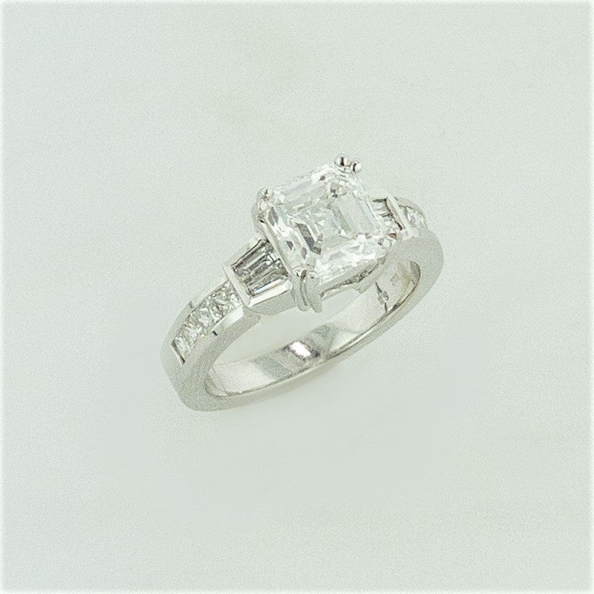 18KW Emerald Cut Diamond w/ Diamond Baguette Accents