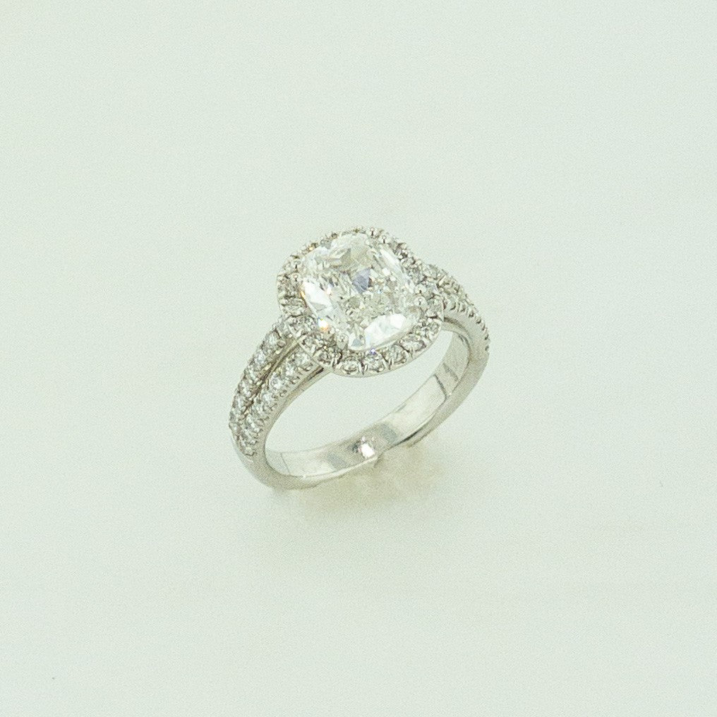 Platinum Cushion Diamond Ring with Diamond Halo