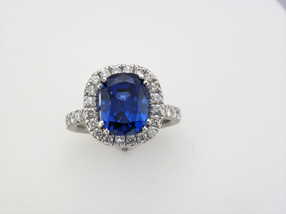 Platinum Tanzanite Ring with Diamond Halo