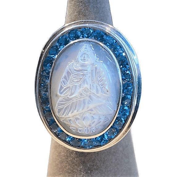 MOTHER OF PEARL BUDDHA RING WITH BLUE TOPAZ