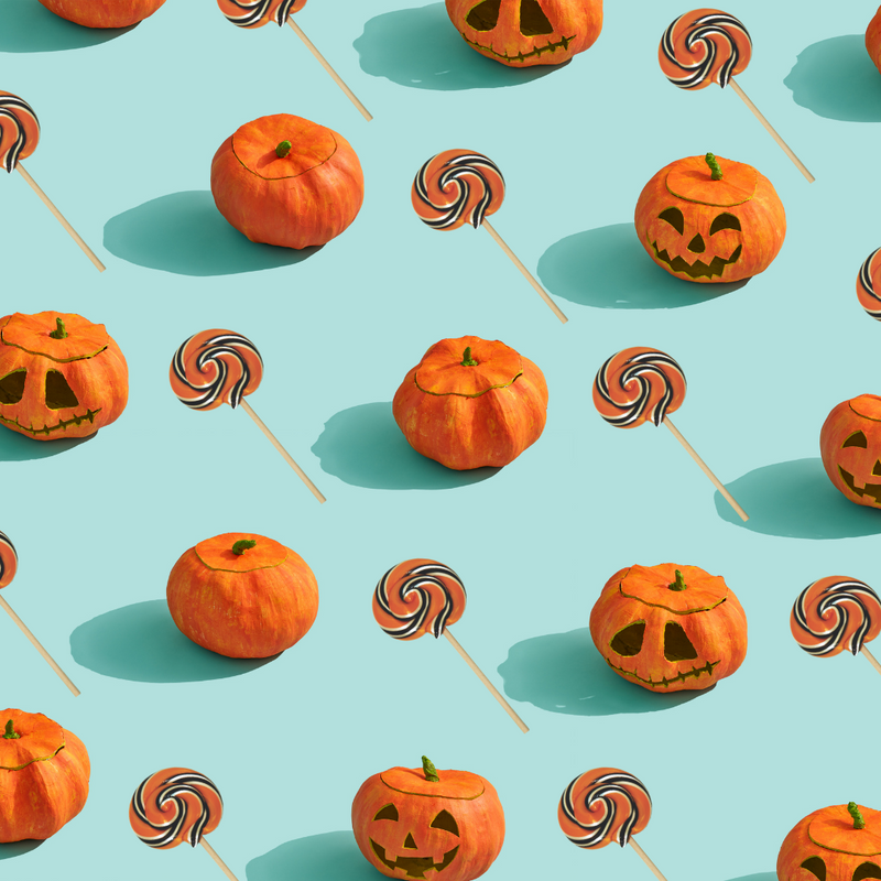 This is a social media image of our halloween lollipop mixed with pumpkins on a blue background.