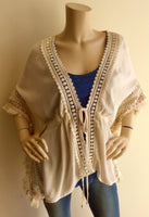 Cream fringe kimono by Sage the label