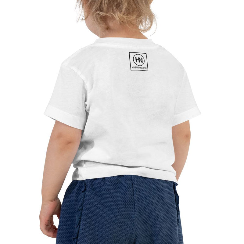 TODDLER IN DIVERSITY WE TRUST SIGNATURE T-SHIRT (WHITE) Toddler Top Printful