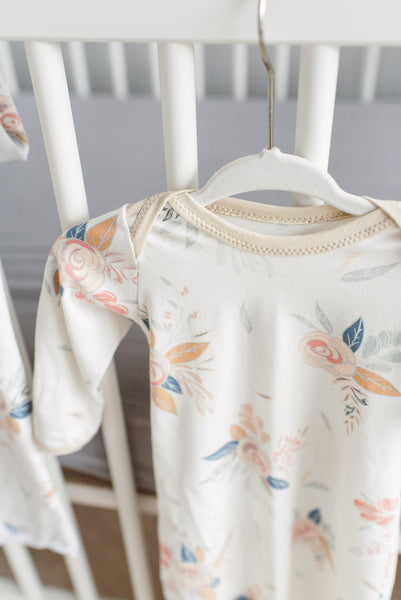 lap-shoulder-baby-gown-for-easy-changing-floral-print-hanging-from-crib-neutral-nursery