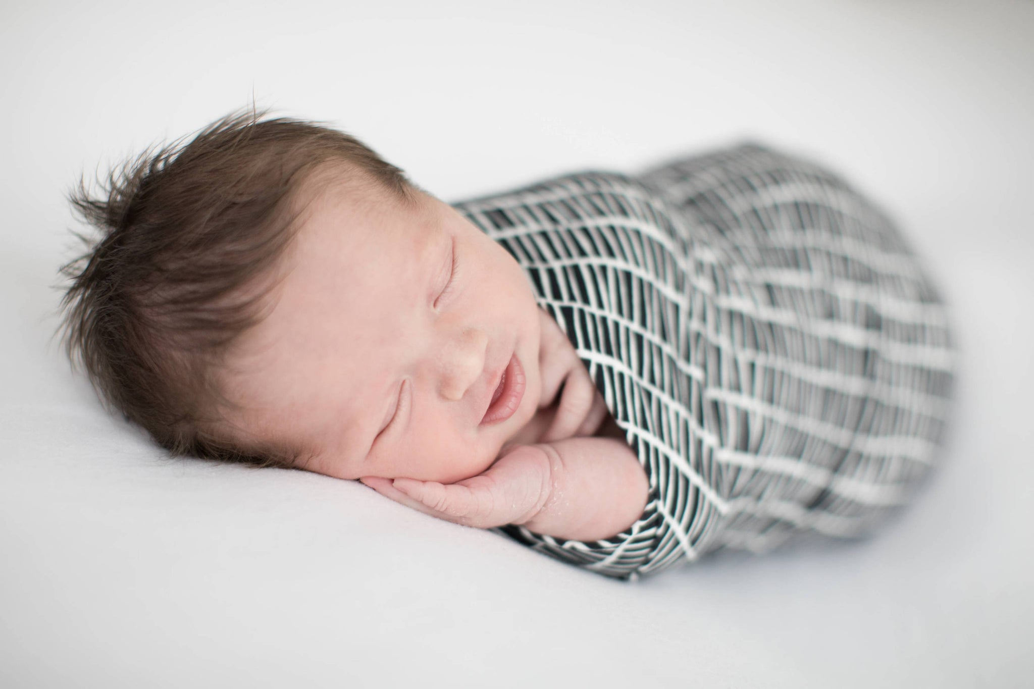 newborn-baby-photography-sweet-sleeping-infant-in-swaddle-set